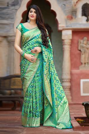 Flaunt Your Rich And Elegant Taste In Silk With This Subtle Weaved Saree In Green Color. This Saree And Blouse Are Fabricated On Banarasi Satin Beautified With Pretty Small Butti Weave All Over It. Its Silk Based Fabric Will Give A Rich Look To Your Personality