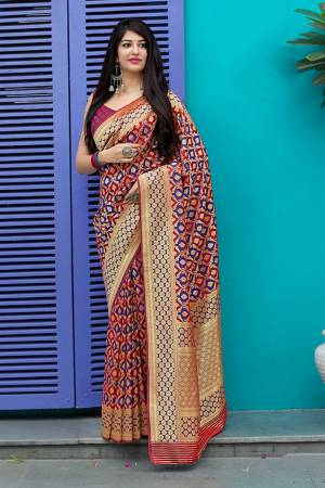 Celebrate This Festive Season With Beauty And Comfort In This Elegant Looking Designer Silk Based Saree In Red And Violet Color. This Saree And Blouse Are Fabricated On Banarasi Satin Beautified With Small Butti Weave All Over. Buy Now.?