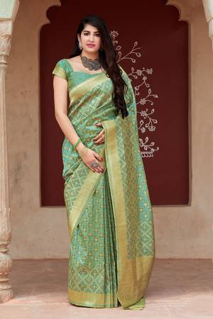 Flaunt Your Rich And Elegant Taste In Silk With This Subtle Weaved Saree In Light Green Color. This Saree And Blouse Are Fabricated On Tussar Art Silk Beautified With Pretty Small Butti Weave All Over It. Its Silk Based Fabric Will Give A Rich Look To Your Personality
