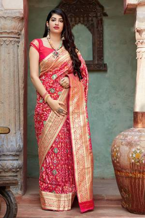 Celebrate This Festive Season With Beauty And Comfort In This Elegant Looking Designer Silk Based Saree In Dark Pink Color. This Saree And Blouse Are Fabricated On Banarasi Tissue Patola Beautified With Small Butti Weave All Over. Buy Now.?