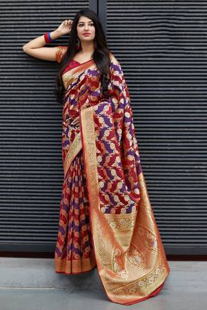 Flaunt Your Rich And Elegant Taste In Silk With This Subtle Weaved Saree In Red And Violet Color. This Saree And Blouse Are Fabricated On Banarasi Patola Beautified With Pretty Small Butti Weave All Over It. Its Silk Based Fabric Will Give A Rich Look To Your Personality