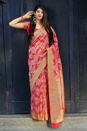 Celebrate This Festive Season With Beauty And Comfort In This Elegant Looking Designer Silk Based Saree In Red And Pink Color. This Saree And Blouse Are Fabricated On Banarasi Satin Beautified With Small Butti Weave All Over. Buy Now.?