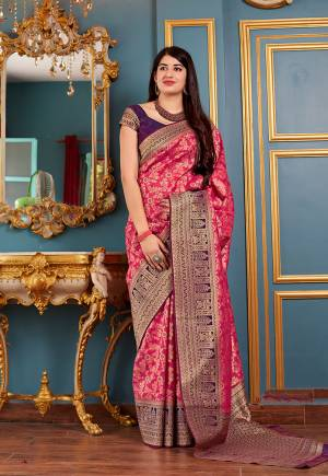 Flaunt Your Rich And Elegant Taste In Silk With This Subtle Weaved Saree In Dark Pink Color. This Saree And Blouse Are Fabricated On Banarasi Art Silk Beautified With Pretty Small Butti Weave All Over It. Its Silk Based Fabric Will Give A Rich Look To Your Personality