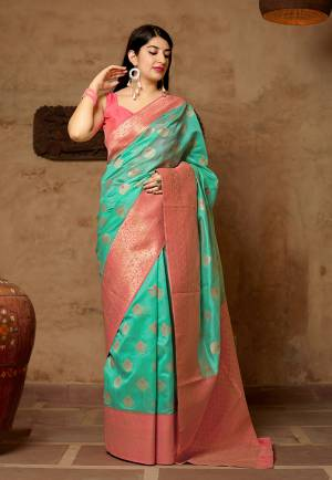 Celebrate This Festive Season With Beauty And Comfort In This Elegant Looking Designer Silk Based Saree In Sea Green Color. This Saree And Blouse Are Fabricated On Banarasi Art Silk Beautified With Small Butti Weave All Over. Buy Now.?