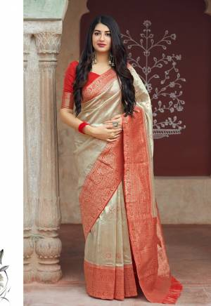 Flaunt Your Rich And Elegant Taste In Silk With This Subtle Weaved Saree In Cream Color. This Saree And Blouse Are Fabricated On Banarasi Art Silk Beautified With Pretty Small Butti Weave All Over It. Its Silk Based Fabric Will Give A Rich Look To Your Personality
