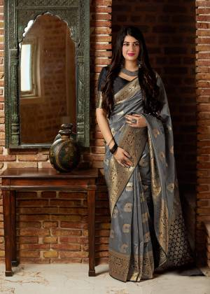 Celebrate This Festive Season With Beauty And Comfort In This Elegant Looking Designer Silk Based Saree In Grey Color. This Saree And Blouse Are Fabricated On Banarasi Art Silk Beautified With Small Butti Weave All Over. Buy Now.?