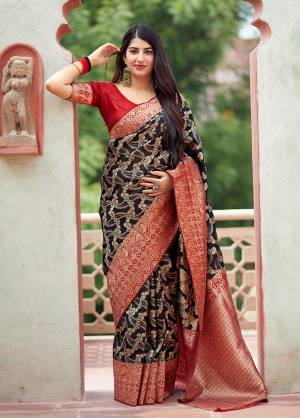 Flaunt Your Rich And Elegant Taste In Silk With This Subtle Weaved Saree In Black Color. This Saree And Blouse Are Fabricated On Banarasi Art Silk Beautified With Pretty Small Butti Weave All Over It. Its Silk Based Fabric Will Give A Rich Look To Your Personality