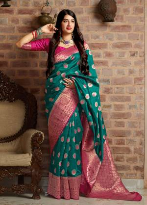 Celebrate This Festive Season With Beauty And Comfort In This Elegant Looking Designer Silk Based Saree In Teal Blue Color. This Saree And Blouse Are Fabricated On Banarasi Art Silk Beautified With Small Butti Weave All Over. Buy Now.?