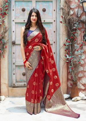 Flaunt Your Rich And Elegant Taste In Silk With This Subtle Weaved Saree In Red Color. This Saree And Blouse Are Fabricated On Banarasi Art Silk Beautified With Pretty Small Butti Weave All Over It. Its Silk Based Fabric Will Give A Rich Look To Your Personality