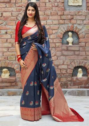 Flaunt Your Rich And Elegant Taste In Silk With This Subtle Weaved Saree In Navy Blue Color. This Saree And Blouse Are Fabricated On Banarasi Art Silk Beautified With Pretty Small Butti Weave All Over It. Its Silk Based Fabric Will Give A Rich Look To Your Personality