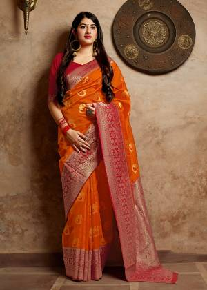 Celebrate This Festive Season With Beauty And Comfort In This Elegant Looking Designer Silk Based Saree In Orange Color. This Saree And Blouse Are Fabricated On Banarasi Art Silk Beautified With Small Butti Weave All Over. Buy Now.?
