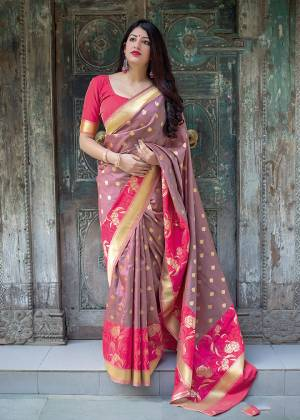 Flaunt Your Rich And Elegant Taste In Silk With This Subtle Weaved Saree In Mauve Color. This Saree And Blouse Are Fabricated On Art Silk Beautified With Pretty Small Butti Weave All Over It. Its Silk Based Fabric Will Give A Rich Look To Your Personality