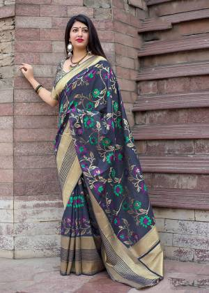 Celebrate This Festive Season With Beauty And Comfort In This Elegant Looking Designer Silk Based Saree In Navy Blue Color. This Saree And Blouse Are Fabricated On Art Silk Beautified With Small Butti Weave All Over. Buy Now.?