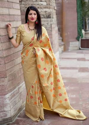 Flaunt Your Rich And Elegant Taste In Silk With This Subtle Weaved Saree In Cream Color. This Saree And Blouse Are Fabricated On Art Silk Beautified With Pretty Small Butti Weave All Over It. Its Silk Based Fabric Will Give A Rich Look To Your Personality
