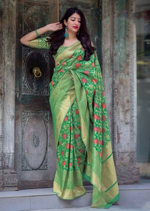 Celebrate This Festive Season With Beauty And Comfort In This Elegant Looking Designer Silk Based Saree In Green Color. This Saree And Blouse Are Fabricated On Art Silk Beautified With Small Butti Weave All Over. Buy Now.?