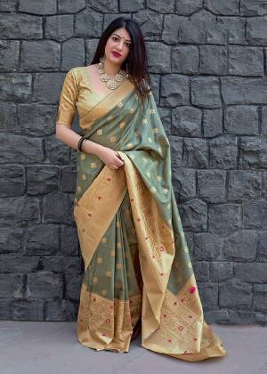 Celebrate This Festive Season With Beauty And Comfort In This Elegant Looking Designer Silk Based Saree In Grey Color. This Saree And Blouse Are Fabricated On Art Silk Beautified With Small Butti Weave All Over. Buy Now.?