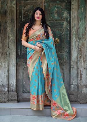 Flaunt Your Rich And Elegant Taste In Silk With This Subtle Weaved Saree In Sky Blue Color. This Saree And Blouse Are Fabricated On Art Silk Beautified With Pretty Small Butti Weave All Over It. Its Silk Based Fabric Will Give A Rich Look To Your Personality