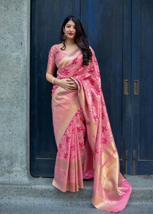 Celebrate This Festive Season With Beauty And Comfort In This Elegant Looking Designer Silk Based Saree In Pink Color. This Saree And Blouse Are Fabricated On Art Silk Beautified With Small Butti Weave All Over. Buy Now.?