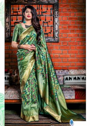 Flaunt Your Rich And Elegant Taste In Silk With This Subtle Weaved Saree In Green Color. This Saree And Blouse Are Fabricated On Banarasi Art Silk Beautified With Pretty Small Butti Weave All Over It. Its Silk Based Fabric Will Give A Rich Look To Your Personality
