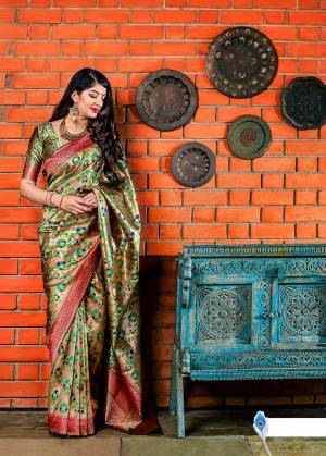 Flaunt Your Rich And Elegant Taste In Silk With This Subtle Weaved Saree In Golden Color. This Saree And Blouse Are Fabricated On Banarasi Art Silk Beautified With Pretty Small Butti Weave All Over It. Its Silk Based Fabric Will Give A Rich Look To Your Personality