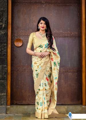 Celebrate This Festive Season With Beauty And Comfort In This Elegant Looking Designer Silk Based Saree In Cream Color. This Saree And Blouse Are Fabricated On Banarasi Art Silk Beautified With Small Butti Weave All Over. Buy Now.?