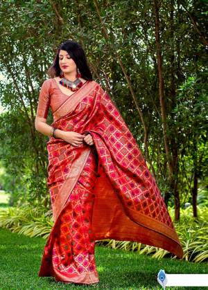 Celebrate This Festive Season With Beauty And Comfort In This Elegant Looking Designer Silk Based Saree In Red Color. This Saree And Blouse Are Fabricated On Banarasi Art Silk Beautified With Small Butti Weave All Over. Buy Now.?