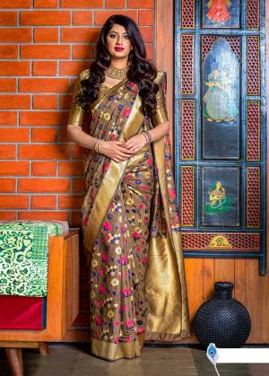 Flaunt Your Rich And Elegant Taste In Silk With This Subtle Weaved Saree In Light Brown Color. This Saree And Blouse Are Fabricated On Banarasi Art Silk Beautified With Pretty Small Butti Weave All Over It. Its Silk Based Fabric Will Give A Rich Look To Your Personality