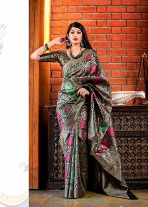 Celebrate This Festive Season With Beauty And Comfort In This Elegant Looking Designer Silk Based Saree In Black & Multi Color. This Saree And Blouse Are Fabricated On Banarasi Art Silk Beautified With Small Butti Weave All Over. Buy Now.?