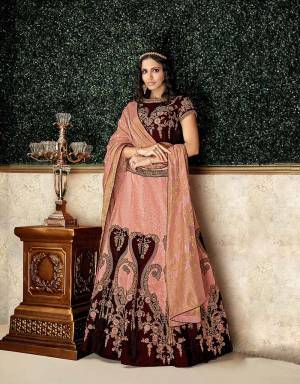 Let luxury become and experience with this regal brocade and velvet lehenga with exquisite embroidery details. Pair with elegant jewelry to complete the look.