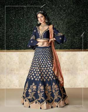 A resplendent confluence of bollywood style and cultural aesthetics , this youthful lehenga will take your fashion sense a notch higher .Drape the dupatta on your neck for that perfect look.