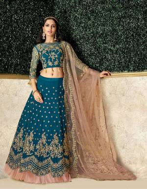 Trending frills added to an evergreen lehenga makes for an exemplary style. The added tassels on the blouse hem makes the design noteworthy.
