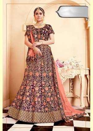 Be The Prettiest Bride Wearing This Very Beautiful And Heavy Embroidered Designer Bridal Lehenga Choli In Purple Color Paired With Contrasting Dark Peach Colored Dupatta. This Lehenga Choli Is Velvet Based Paired With Net Fabricated Dupatta. Buy This Beautiful Lehenga Choli Now.