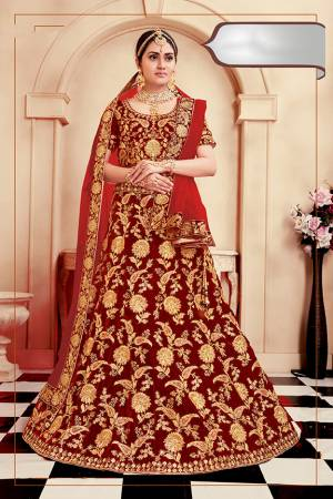 Be The Prettiest Bride Wearing This Very Beautiful And Heavy Embroidered Designer Bridal Lehenga Choli In Red Color. This Lehenga Choli Is Velvet Based Paired With Net Fabricated Dupatta. Buy This Beautiful Lehenga Choli Now.