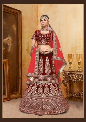 Be The Prettiest Bride Wearing This Very Beautiful And Heavy Embroidered Designer Bridal Lehenga Choli In Maroon Color Paired With Contrasting Red Colored Blouse. This Lehenga Choli Is Velvet Based Paired With Net Fabricated Dupatta. Buy This Beautiful Lehenga Choli Now.