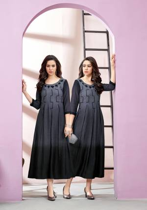 For A Bold And Beautiful Look, Grab This Designer Readymade Long Kurti In Grey And Black Color Fabricated On Rayon Slub. Its Fabric Is Soft Towards Skin And Easy To Carry All Day Long.
