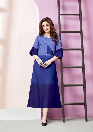 Add Some Semi-Casuals Wearing This Designer Readymade Long Kurti In Shades Of Blue. It Is Fabricated On Rayon Slub. It Is Light Weight And Easy To Carry All Day Long.