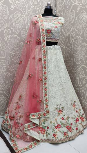 Rich And Elegant Looking Heavy Designer Lakhnavi Lehenga Choli Is Here In White Color Paired With Pretty Pink Colored Dupatta. This Heavy Embroidered Lehenga Choli Is Fabricated On Georgette Paired With Net Fabricated Dupatta. Buy This Lovely Piece Now.
