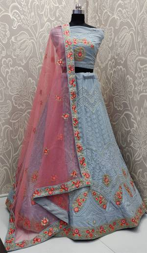 You Will Definitely Earn Lots Of Compliments Wearing This Heavy Designer Lakhnavi Lehenga Choli In Powder Blue Color Paired With Contrasting Pink Colored Dupatta. This Lehenga Choli Is Fabricated On Georgette Paired With Net Fabricated Dupatta. Buy Now.