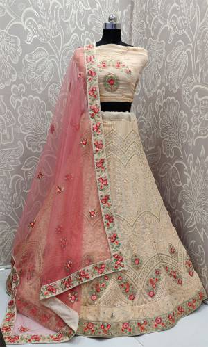 Get Ready For The Upcoming Wedding Season With This Very Beautiful And Heavy Designer Lehenga Choli In Peach Color Paired With Contrasting Pink Colored Dupatta. Its Blouse And Lehenga Are Georgette Based Paired With net Fabricated Dupatta. It IS Beautified With Heavy Lakhnavi Embroidery.