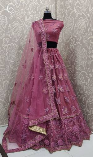 Get Ready For The Upcoming Wedding Season With This Very Beautiful And Heavy Designer Lehenga Choli In All Over Dark Pink Color. This Heavy Embroidered Lehenga Choli Is Fabricated On Net Beautified With Tone To Tone Embroidery.
