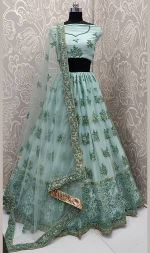 Get Ready For The Upcoming Wedding Season With This Very Beautiful And Heavy Designer Lehenga Choli In All Over Aqua Green Color. This Heavy Embroidered Lehenga Choli Is Fabricated On Net Beautified With Tone To Tone Embroidery.