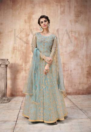 Add This Very Pretty Heavy Designer Floor Length Suit To Your Wardrobe In All Over Sky Blue Color. Its Heavy Embroidered Top IS Fabricated On Net Paired With Satin Silk Bottom And Net Fabricated Dupatta. It Is Light In Weight And Easy To Carry Throughout The Gala. Buy Now.