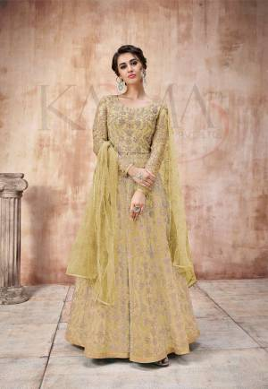 Add This Very Pretty Heavy Designer Floor Length Suit To Your Wardrobe In All Over Pear Green Color. Its Heavy Embroidered Top IS Fabricated On Net Paired With Satin Silk Bottom And Net Fabricated Dupatta. It Is Light In Weight And Easy To Carry Throughout The Gala. Buy Now.