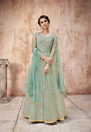 Add This Very Pretty Heavy Designer Floor Length Suit To Your Wardrobe In All Over Aqua Blue Color. Its Heavy Embroidered Top IS Fabricated On Net Paired With Satin Silk Bottom And Net Fabricated Dupatta. It Is Light In Weight And Easy To Carry Throughout The Gala. Buy Now.
