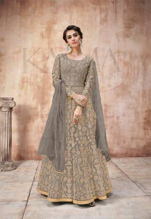 Add This Very Pretty Heavy Designer Floor Length Suit To Your Wardrobe In All Over Grey Color. Its Heavy Embroidered Top IS Fabricated On Net Paired With Satin Silk Bottom And Net Fabricated Dupatta. It Is Light In Weight And Easy To Carry Throughout The Gala. Buy Now.