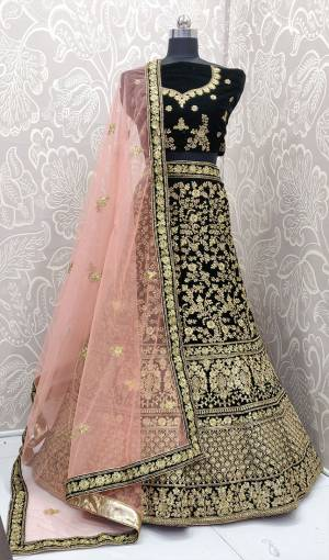 Here Is A Heavy Embroidered Designer Bridal Lehenga Choli For Your D-Day. This Heavy Velvet Based Lehenga Choli Is In Dark Green Color Paired With Baby Pink Colored Net Fabricated Dupatta. It Is Beautified With Heavy Jari And Coding Embroidery With Stone Work.