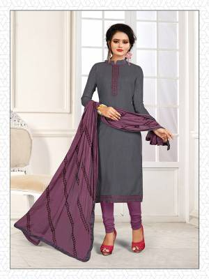 If Those Readymade Suit Does Not Lend You The Desired Comfort, Than Grab This Pretty Dress Material In Grey And Purple And Get This Stitched As Per Your Desired Fit And Comfort. Its Top Is Fabricated On Cotton Slub Paired With Cotton Bottom And Chiffon Fabricated Dupatta.