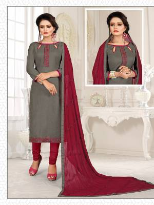 Here Is A Pretty Dress Material For Your Casual Or Semi-Casual Wear In Grey And Maroon Color. Its Top Is Fabricated On Cotton Slub Paired With Cotton Bottom And Chiffon Fabricated Dupatta. Get This Stitched As Per Your Desired Fit And Comfort.