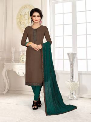 Here Is A Pretty Dress Material For Your Casual Or Semi-Casual Wear In Brown And Teal Green Color. Its Top Is Fabricated On Cotton Slub Paired With Cotton Bottom And Chiffon Fabricated Dupatta. Get This Stitched As Per Your Desired Fit And Comfort.
