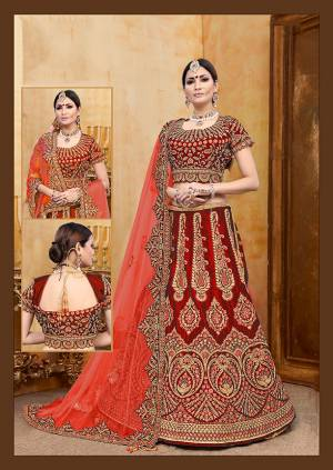 Get Ready For Your D-Day With This Heavy Designer Bridal Lehenga?Choli In Red Color Paired With Red Colored Dupatta. Its Heavy Embroidered Blouse And Lehenga Are Fabricated On Velvet Paired With Net Fabricated Dupatta.